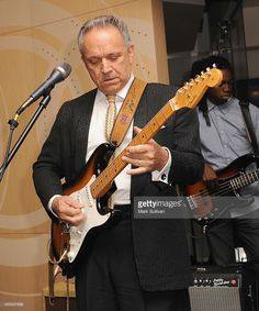 Jimmie Vaughan performs during the Stevie Ray Vaughan exhibit launch ...