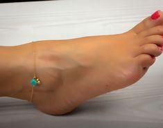 "Turquoise anklet, ankle bracelet, gold anklet, foot jewelry, gold ankle bracelet, charm anklet, delicate anklet, bridesmaid gift,""Okeanides"". $21.50, via Etsy."