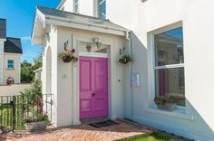 20 Warren Road, Donaghadee. Love the pink door. Hate the interior.