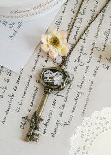 I want my wedding themed with pale colors, twinkle lights, lanterns, glitter, Vintage keys & crosses ;) ECH