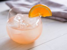 Great Gatsby 1 ounce vodka 1 ounce Lillet Blanc 2 1/2 ounces freshly squeezed grapefruit juice Garnish: orange slice