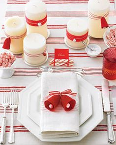 Red and white Christmas tablescape. Love the bells. Christmas Simple Party Ideas - love the striped table cloth Via Junk Garden Christmas Table Settings, Christmas Tablescapes, Christmas Table Decorations, Christmas Themes, Christmas Holidays, Holiday Tablescape, Christmas Candles, Xmas, Holiday Centerpieces