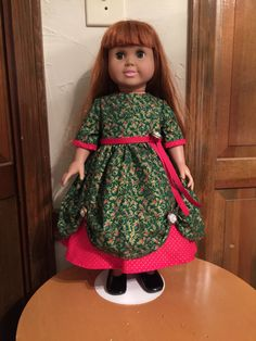A personal favorite from my Etsy shop https://www.etsy.com/listing/496450981/ag-christmas-dress-red-green-and-gold