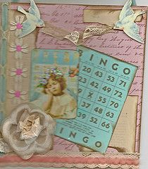 altered bingo card on canvas with vintage lace, trims, etc