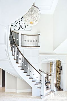 """Original Thought: A Tudor Is Reimagined Edelmann-followed the architect's lead with immediate changes to give the house's time-honored features a more stylish yet streamlined demeanor. """"I redesigned the grand staircase, chose a lighter stain for the home's wide-plank floors and changed tiling, fixtures, lighting and millwork wherever we could,"""" she explains."""