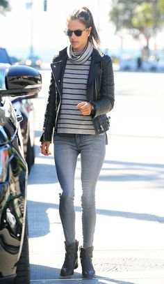 Alessandra Ambrosio pairs an Anine Bing leather jacket with a striped turtleneck, gray skinny jeans and black boots