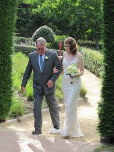 And here she comes.... Stunning Bride and lovely flowers too.. Contact: floralology@yahoo.com.au