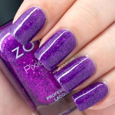 Zoya PixieDust Nail Polish in Carter (15ml / 0.50 fl oz) is a cool-toned, deep purple tinted base polish with a ton of purple glitter. With top coat.