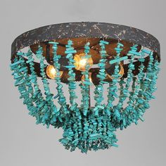 Taking on a rustic charm, the Coastal turquoise beaded ceiling light dds an exotic feel to your home.