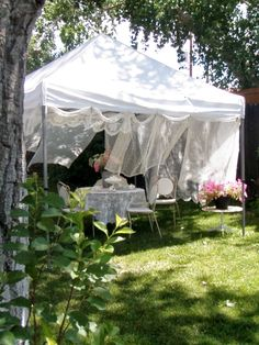 Cabin & Cottage : Anatomy of A Summer Garden Party.  How fun, with old lace curtains.