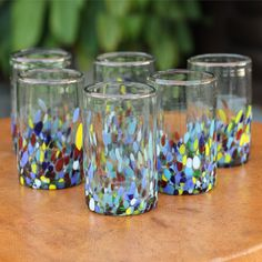Add a pop of color to any kitchen or dining area with these fun colored drinking glasses. They featured a hand-blown construction that's made from recycled materials, so they're environmentally friendly, and they also have a colorful confetti pattern.
