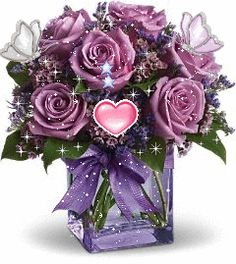 PURPLE ROSES THAT SPARKLE, WHITE BUTTERFLIES THAT MOVE , AND A LITTLE PINK HEART THAT BEATS.