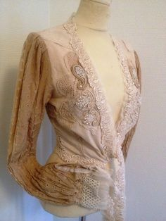 RAW RAGS wrap , made from beautiful fabrics and laces, have beading around the sleeves. Very romantic piece.