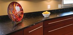 Artisan Soapstone - Natural Stone Countertops. Let NewGraniteMarble.com complete your next countertop project!