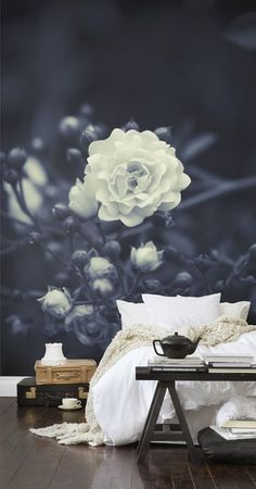 Amazing over scaled floral wall behind the bed.