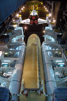 In high bay 3 of the Vehicle Assembly Building at Kennedy Space Center a crane lowers space shuttle Discovery toward the external tank and solid rocket boosters already stacked on the mobile launcher platform in preparation of STS-124 mission to the International Space Station (2008).