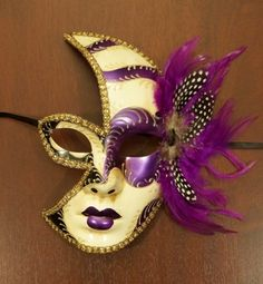 Half moon/half face purple and gold masquerade mask with purple feathers <3