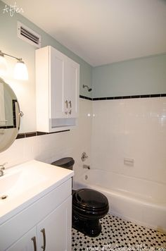 After - beach house bathroom with black and white tile, Benjamin Moore Palladian Blue paint and black toilet