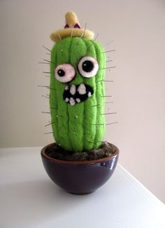 Haha, this guy is funny.  Could make a non-zombie version of a cactus pincushion