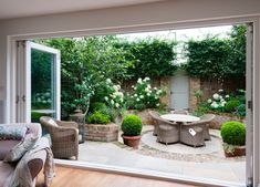 I like the circular design of this small backyard patio, connected to indoors with huge patio doors