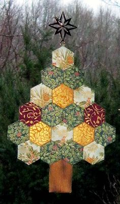 The Inchy Hexagon Flower Swap: Hexagon Christmas Tree - Picture only - possibly make with cardboard hexagons and yo-yo fabric circles. Blind stitch together & maybe embroider joins.