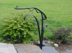 DescriptionMaker details This small hand-forged railing provides a visual accent and a transition from the deck to the garden and walkway Dimensions high by long by wide Sculptural Hand Railing Porch Handrails, Outdoor Stair Railing, Front Porch Railings, Iron Handrails, Porch Stairs, Rod Iron Railing, Wrought Iron Stair Railing, Metal Railings, Hand Railing