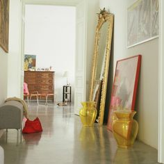 Sleek polished concrete floor enhanced color added with bright accessories.