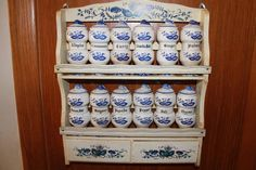 """Vintage """"Blue Onion"""" spice rack with 12 jars and wooden rack with drawers by Rossini. Made in Japan, circa 1960s."""