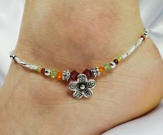 Silver flower anklet, ankle bracelet made with Swarovski crystals and Czech glass. Part of my new tropical flower collection of anklets. ~ Tropical flower charm ~ Swarovski crystal beads in bright fuchsia, sunshine orange, and peridot green ~ Silver-lined Czech glass twist tube beads around sides with matching fuchsia, orange, and peridot Czech glass seed bead accents ~ All metal beads to include charm and lobster claw clasp are Tibetan silver ~ Strung on strongest wire available, double…