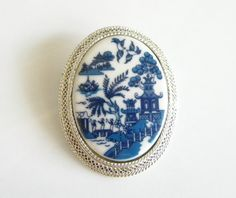 Blue Delft vintage brooch (It matches my china pattern!) http://www.VintageAndVictorian.etsy.com