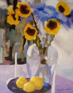 An original Oil painting of Sunflowers and blue-violet spider mums in a glass vase set next to a bowl of lemons.
