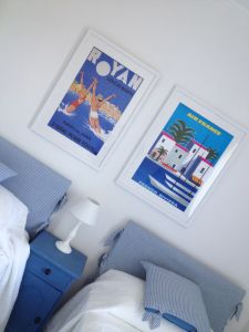 Vintage travel posters make the colours 'pop' in the this pretty bedroom Pretty Bedroom, Two Bedroom, Double Window, French Country House, Poster Making, Vintage Travel Posters, Colours, Pop, Home Decor