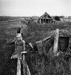 Robert Capa - USSR. 1947. Girl sitting on wooden fence on a collective farm.