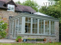 A stone-faced orangery with a solid flat roof