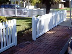 vinyl front yard fence in straight pickets. This simple design is a beautiful no fuss yard enclosure.  www.jameshardware.com
