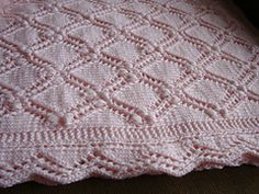This beautiful blanket uses a traditional Estonian stitch pattern. The coordinating decorative lace edging is not Estonian, but it makes for an easier project by knitting it alongside the main portion of the blanket.