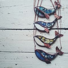 Stained glass whale necklaces. Made with clear glass and pressed flowers!