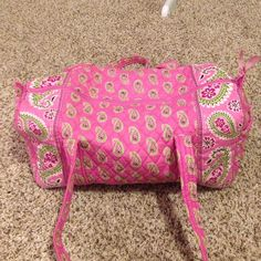 Vera Bradley duffle bag Barely used. Perfect condition. One side pocket on the outside. Measures 22 inches at its widest point. No flaws on the inside, outside or bottom. Vera Bradley Bags Shoulder Bags
