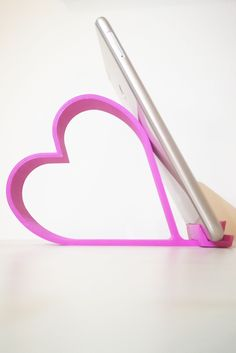 The pink version of our Heart Shaped Phone Holder. We can design and print any shaped of phone holder on demand. Cell Phone Stand, Can Design, Phone Holder, 3d Printer, Heart Shapes, Phone Accessories, Neon, Messages, Technology