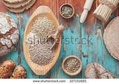 Assorted grains and bread. Preparing food concept, country  style . Bread full rich grains and natural ingredients.  Top view, vintage toned  - stock photo
