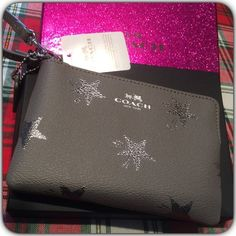 Coach Wristlet with Glitter Box Beautiful Gray and Silver Wristlet. New with tags. Comes in a beautiful Dark pink Glitter box and a Coach Bag. Grab it while is here! Coach Bags Clutches & Wristlets