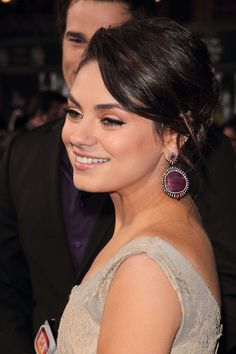 mila kunis is our drop earring inspiration