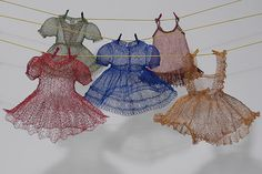 "by Karen Searle - 'How My Mother Dressed Me' (detail); copper wire, hand knitting;   dresses 6"" high"