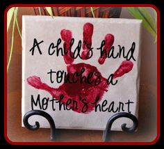 Super Saturday Crafts: A child's hand, touches a Mother's heart