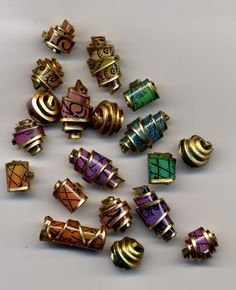 "Shrinky dink beads -- made by ""turning"" heated plastic onto a bead-making tool."