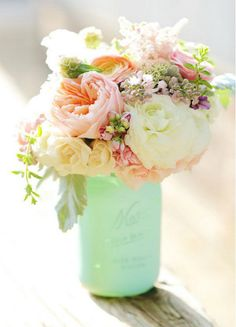 Mason Jar Ideas - I don't like the green wrap around the jar, but love the flowers.