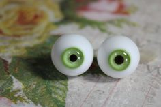 This is a pair of gorgeous and rare antique glass green eyes. They measure 30 x 20 mm and are in excellent condition. These could be