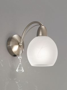 FL2277/1 Thea single wall light, satin nickel & alasbaster glasses. Modern satin nickel effect fitting with alabaster effect glass and a faceted crystal drop. Double Insulated Switched with Rocker Switch 1 x 40w E14 Candle lamps not included Height- 20cm Width- 12cm Projection- 23cm BRAND- Franklite REFERENCE- FL2277/1 AVAILABILITY: 3-4 Working Days