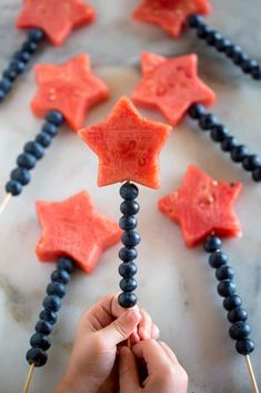 Fruit Sparklers made with watermelon cut into stars and blueberries stacked on a bamboo skewer. A fun way to celebrate holidays or a fun summer snack.If you're looking for a fun and patriotic recipe idea for a summer bbq or party, these Fruit Sparklers Memorial Day Desserts, 4th Of July Desserts, Fourth Of July Food, 4th Of July Party, July 4th, Cute Food, Good Food, Fruits Decoration, Decoration Party