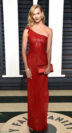 Supermodel style: Karlie Kloss, 24, looked stunning in a scarlet sequin one-shouldered column dress as she attended the Vanity Fair Post Oscar Party at the Wallis Annenberg Centre in California on Sunday night